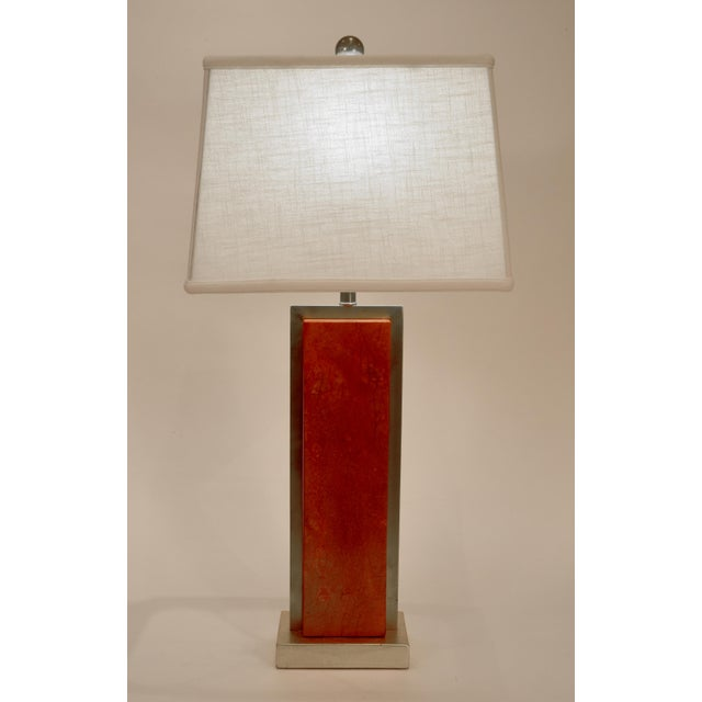 Pair of orange jade task / table lamps with brass frame accent design details with gold wooden base. Each lamp is in...