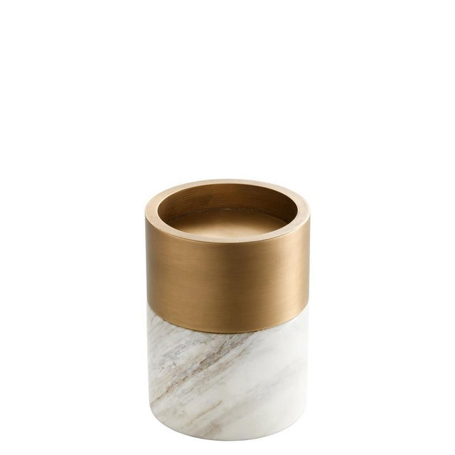 Mixed materials add refinement to the simple design of this 3-piece set of Sierra Candle Holders. Comprised of white...