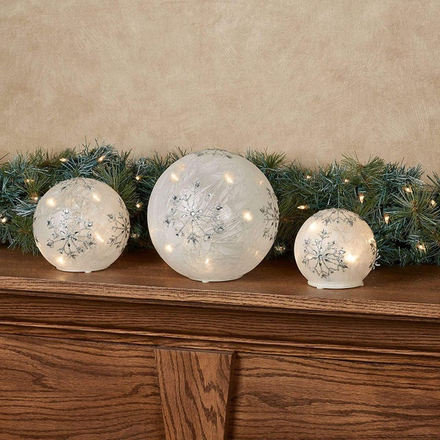 The Snowflake LED Lighted Globe Set sparkles and shines with holiday grace. Each frosted white glass globe features silver...