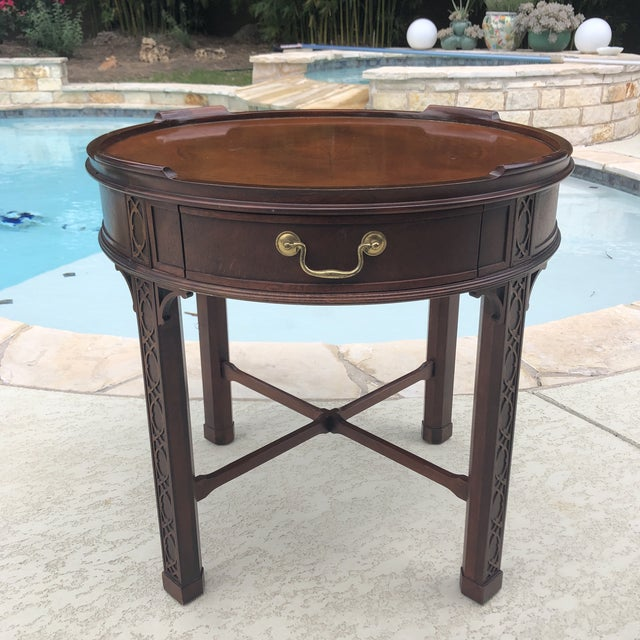 """Beautifully crafted Baker Furniture Chippendale Style Table with ornate detail on legs. Measures 25"""" tall and 25.5"""" in..."""