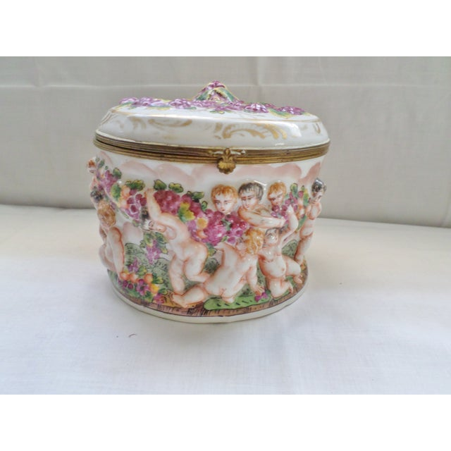This is an Antique Rare Early Signed Capodimonte Porcelain Hinged Box with Cherubs and Flowers Playing with Garlands of...