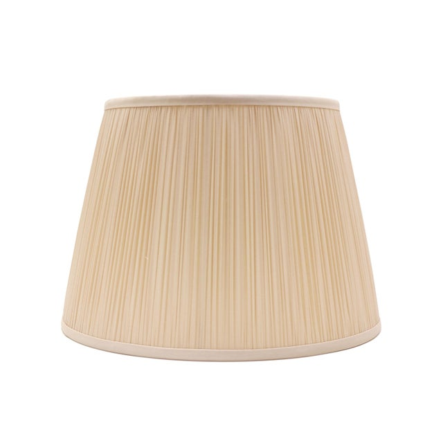 The solid silk shirred shade is an elegant style that elevates the most refined lamp. We use a champagne finish in the...