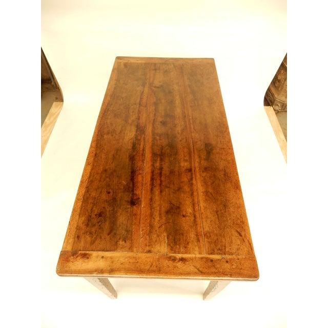 Early 19th century French Provincial walnut farm table. Very nice warm patina.
