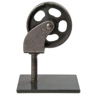 Metal Wheel on Iron Stand