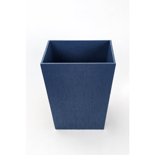 Linen covered waste basket painted a deep blue, good for storage.