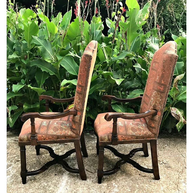 Awesome pair of tall-back arm chairs. Solid wood arms and legs with a cross style base. Unusual tapestry texture fabric...