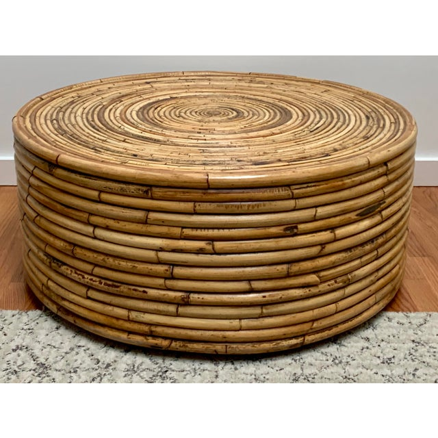"Large pencil reed coffee table measuring about 36"" diameter x 15"" high. The table is made of wood and bentwood, artfully..."