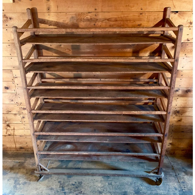 Offering a fantastic vintage bakery shelf. Used for holding loaves of bread to cool. It has cool angled wheels on the...