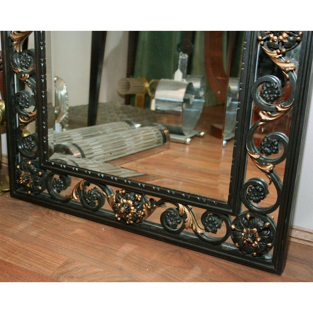 French Art Deco mirror attributed to Gilbert Poillerat in patinated wrought iron with gilt accents, circa 1940s.