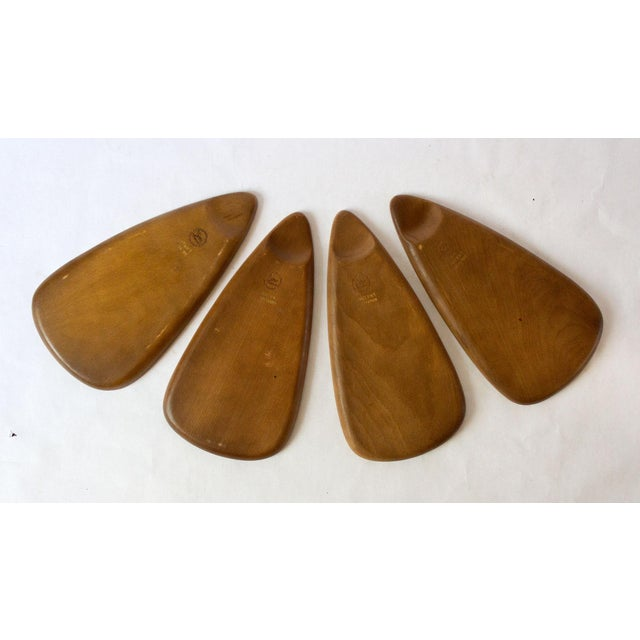 "Set of 4 classic snack trays in teak and cork. Made by Serv Wood in Japan. Each measures 10.63"" L x 5.5"" W x .63""H."