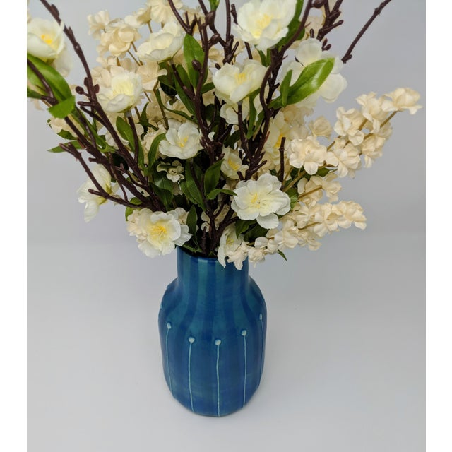 Handmade in Thailand, this vase evokes a modern, yet bohemian a vibe. This mix of colors ranging from ink blue, navy, dark...