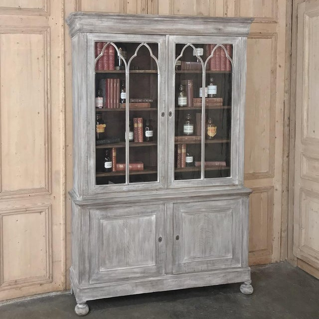 19th Century French Louis Philippe Period Whitewashed Bookcase is a study in tailored elegance, with signature molded...