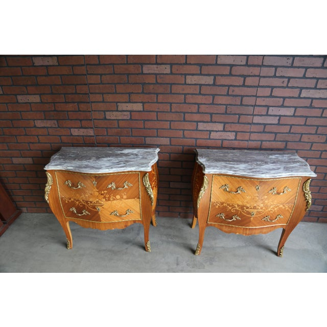 Magnificent Antique French nightstands with marble tops. These nightstands are incredible. The intricately patterned...