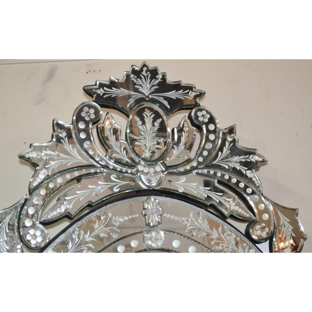 Superb Venetian etched glass beveled edge wall or console mirror with a finely contoured crest and a large leaf-shaped...