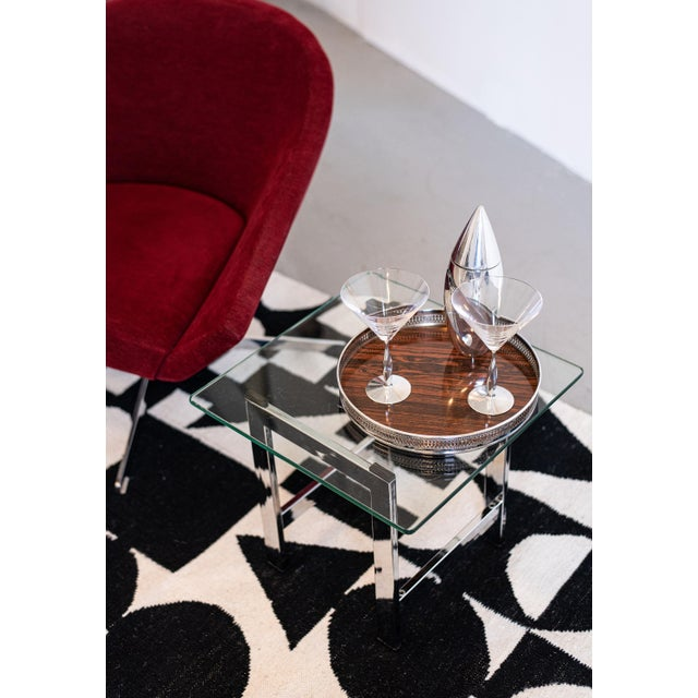 Add some serious style and glam to any room with this pair of vintage Milo Baughman style polished chrome and glass end...