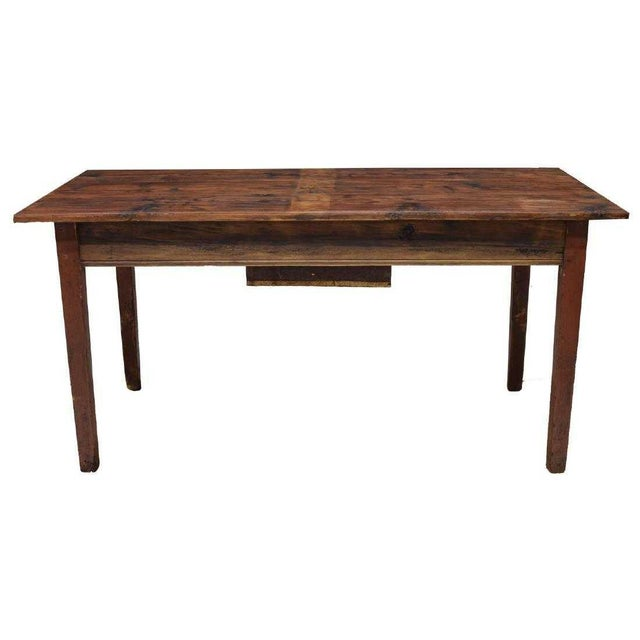 This is great rustic pine work table from Denmark. It was made in the early to mid 20th c. It consists of a rectangular...
