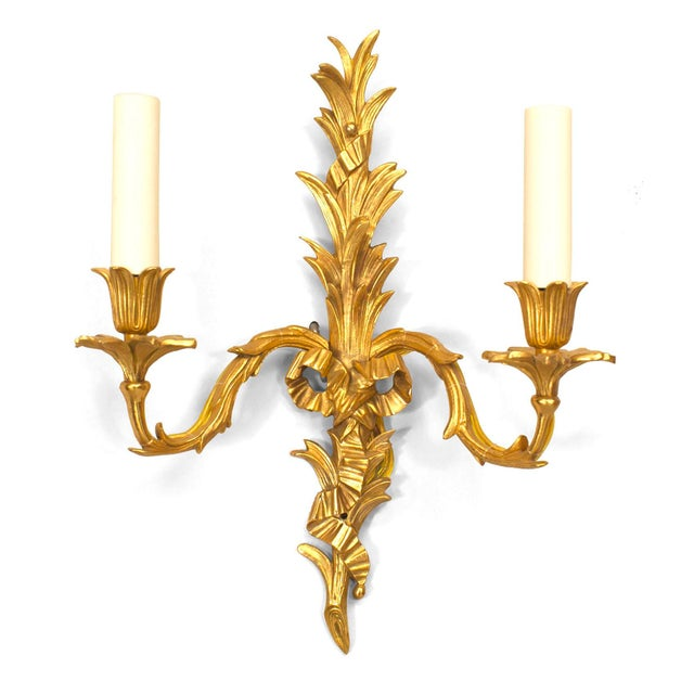 Pair of French Louis XV style 20th century gilt bronze two-arm wall sconces with palm design and bow knot (Priced per pair).