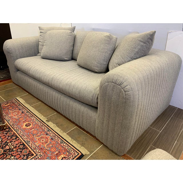 Luxurious and comfortable Donghia sofa designed by John Hutton is upholstered in a soft gray wool blend fabric with...