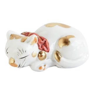 Vintage Japanese Kutani Porcelain Sleeping Cat Figurine Bow with Bells Neku Figurine For Sale