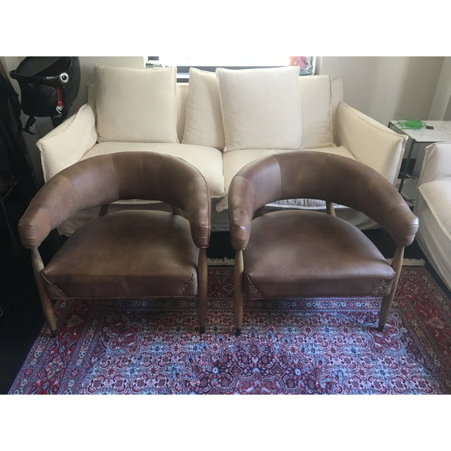 A Pair of Jensen Chairs in a distressed whiskey leather with a black oak drifted finish. I love these chairs. They are...