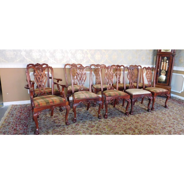 Description: This is a very good set of 10 solid mahogany Chippendale style dining room chairs. Imported reproductions,...