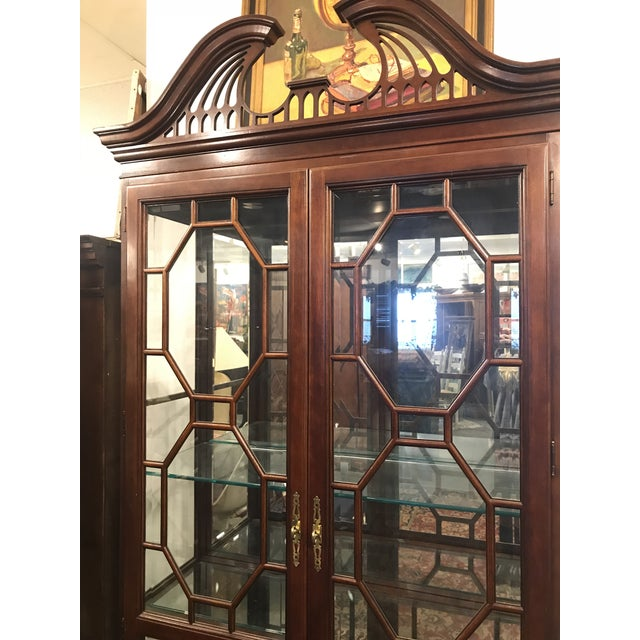Beautiful contemporary mahogany china cabinet with mirror back and glass shelving. Includes interior lighting.
