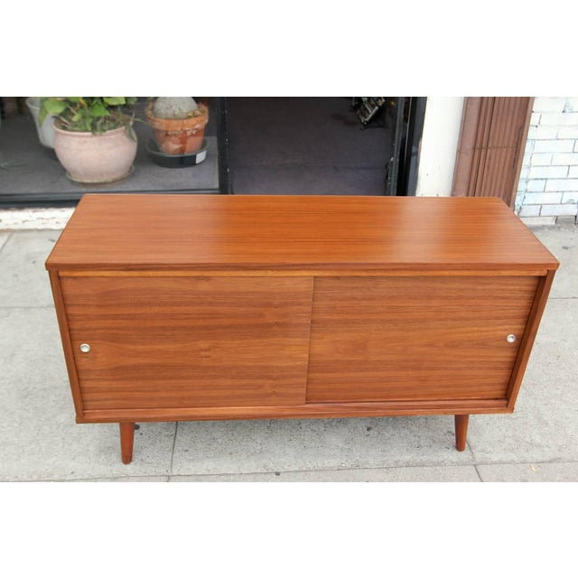 Beautiful hand made in sunny Los Angeles, California. This is one of our best sellers, four feet American walnut credenza...