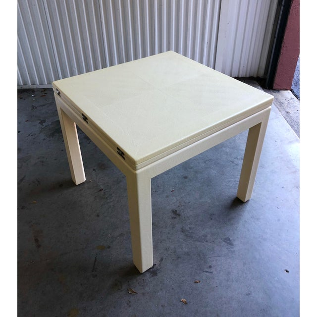 Stunning square flip top extendable dining table. Wrapped in beautiful white reptile leather. Done in the manner of Karl...