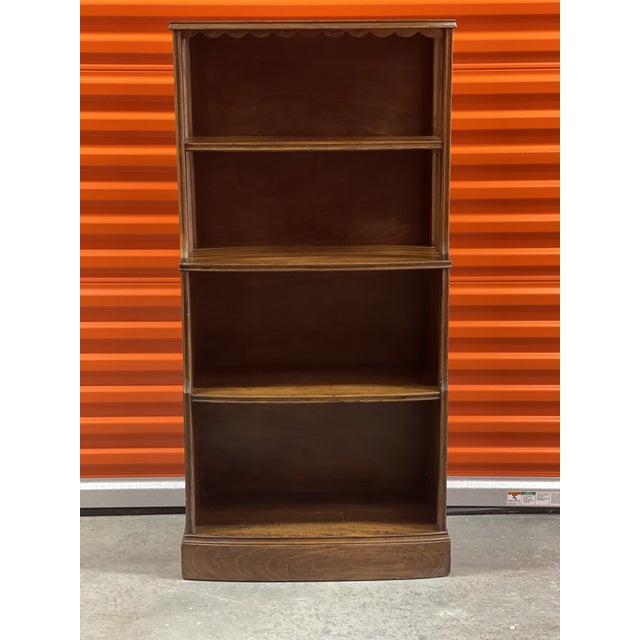 Early American waterfall style bookcase with unique style. The book case has fixed shelves and in good vintage condition.