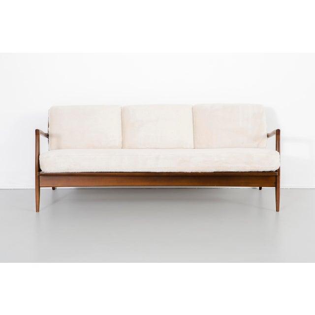 "sofa designed by IB Kofod-Larsen for Selig Denmark, c 1950s reupholstered with Holly Hunt Faux Fur + teak wood 28 ¼"" h x..."
