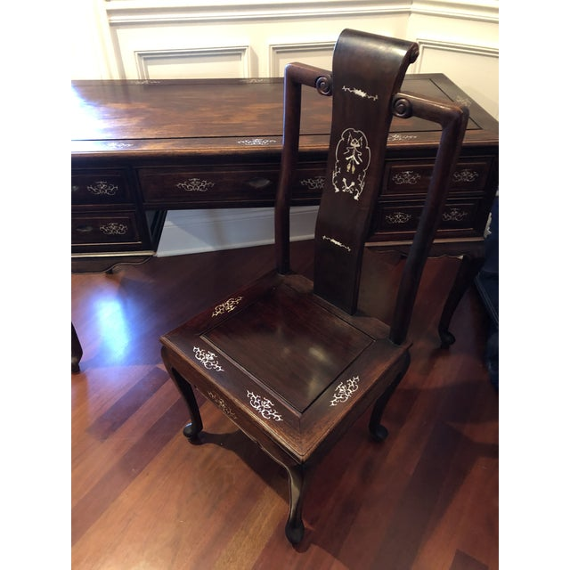 Authentic Chinese Desk and chair purchased in Shanghai in the 1980's. Rosewood with beautiful mother of pearl inlay details.