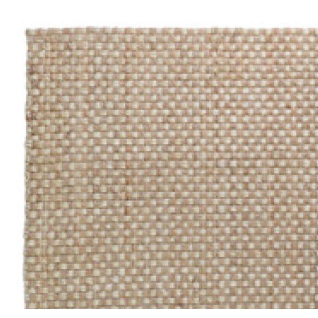 Our Basket Weave rug recreates the titular pattern in warm natural and bleach tones for a look that is uniquely versatile....
