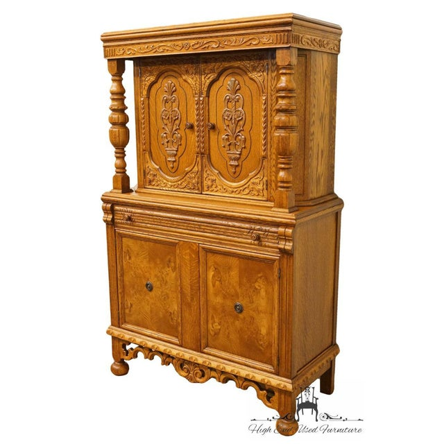 1920's Antique Jacobean Gothic Revival solid oak cupboard with 4 doors and a single drawer.