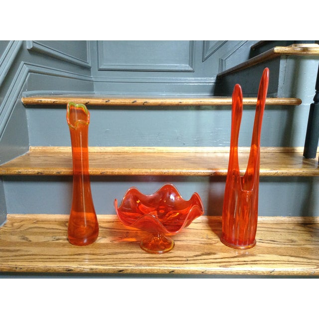 Add sculptural form and a pop of orange color to your space with this set of 3 Mid-century vases. Tallest: 19.5 H x 4 D x...