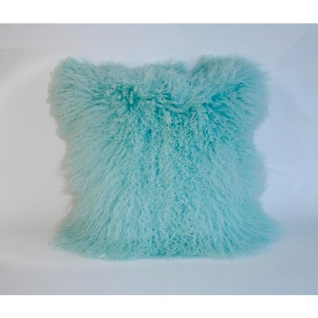 Luscious and tactile Tibetan long curly lamb pillow in a soft Caribbean blue face and neutral velvet back. We suggest...