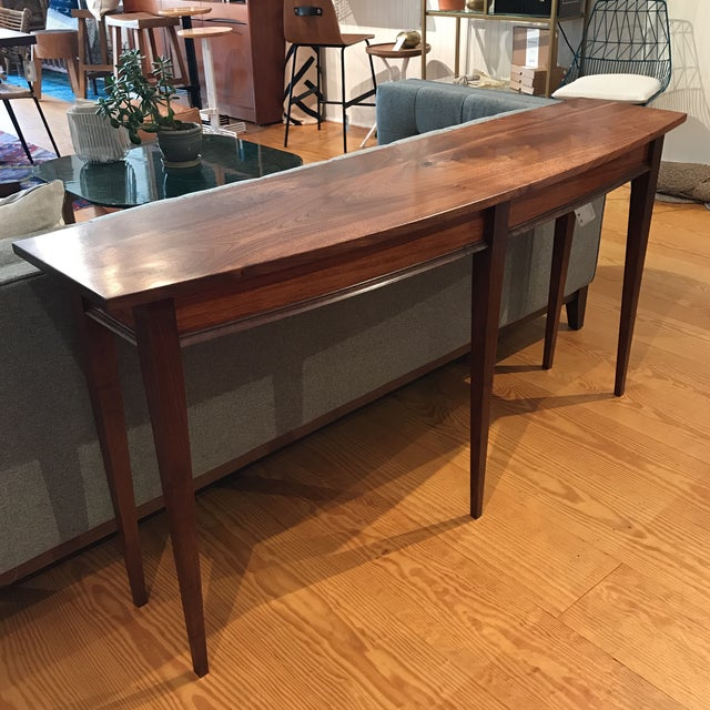 Elegantly styled black walnut console table with tapered legs. You'll absolutely love the feel of its natural wood finish,...