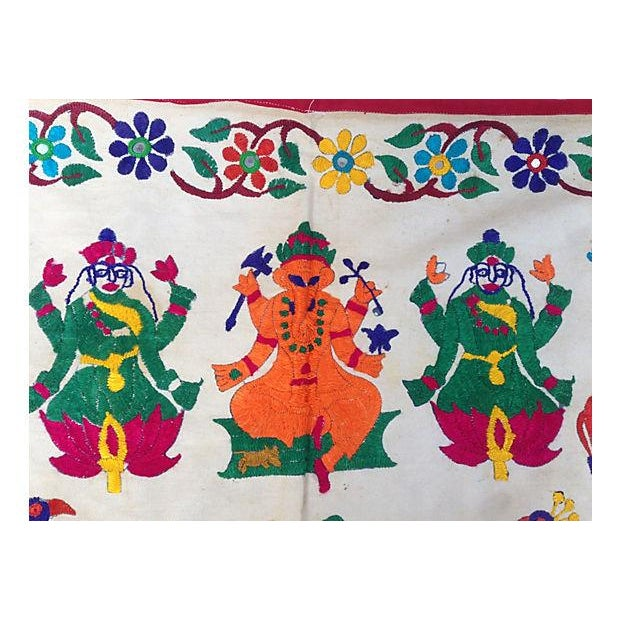 Hand-embroidered mirrored cotton widow valance. Ganesha, the god of wisdom, adorned with horses and peacocks. Purchased in...