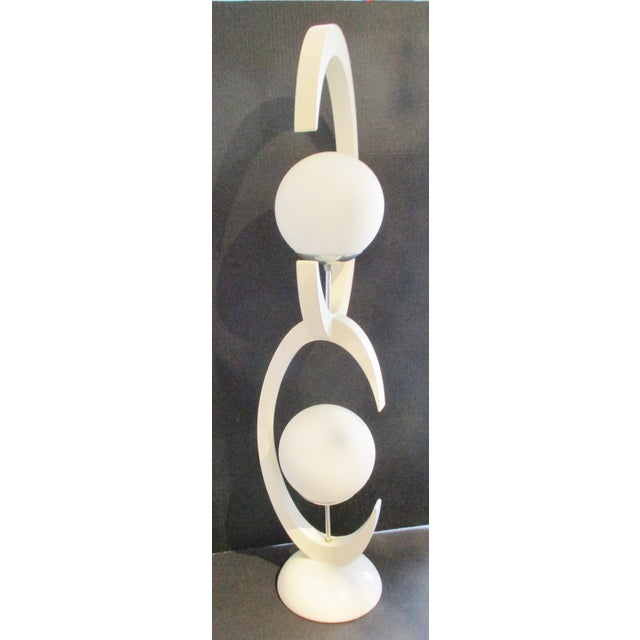 Large Mid-Century Modern White Lacquer Double Globe Lamp by Modeline c. 1974 It is in good working order. The lamp is made...