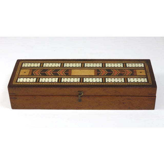 A beautiful antique cribbage board game box. It is completely hand made out of solid mahogany. The top has fine marquetry...