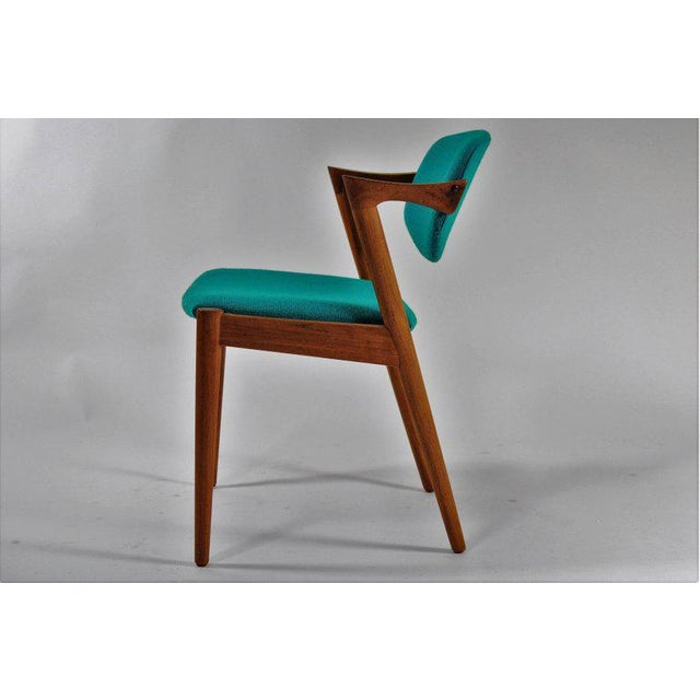 Model 42 teak dining chair with adjustable backrest by Kai Kristiansen for Schous Møbelfabrik. The chair have Kai...