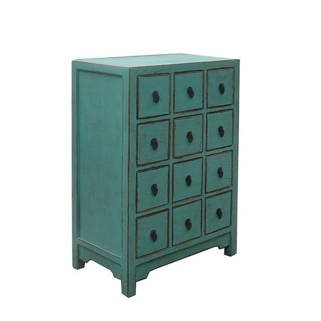 A Chinese rustic turquoise elm wood ide table cabinet with twelve small drawers for accessories storage. Its bright light...