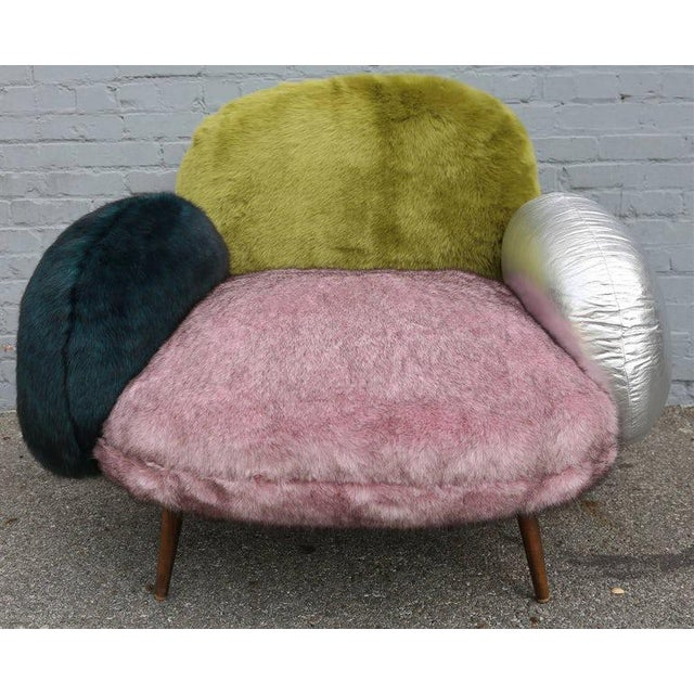 Extremely comfortable lounge chair made with faux fur and leather. Can be customized with different colors and materials....
