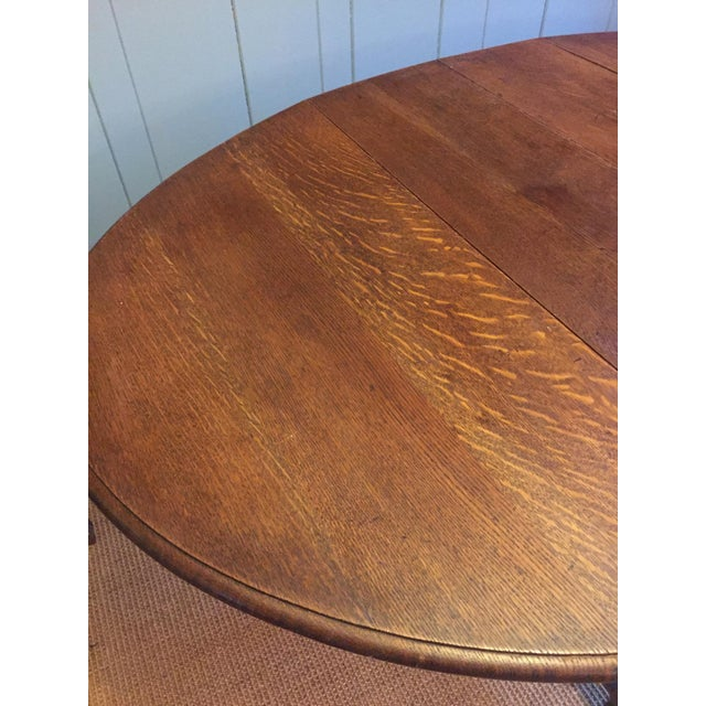 Barley twist leg, drop leaf oval dark oak dining table. Size 60x41x29. Average ware for age, some repairs but very...