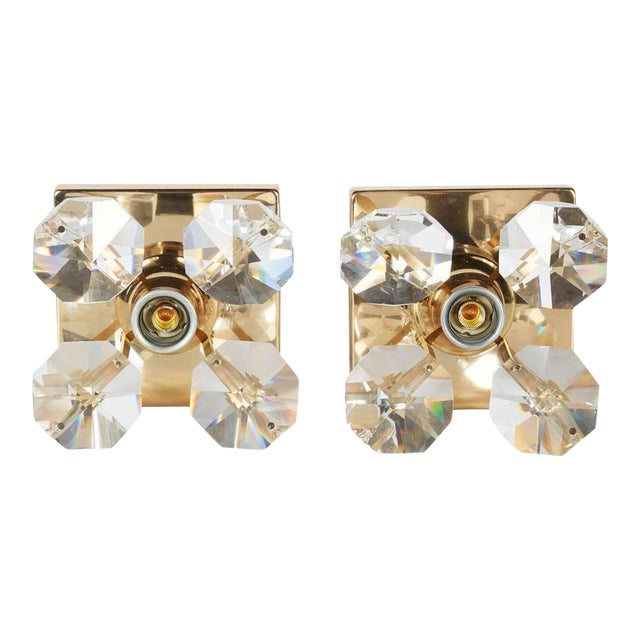 Pair of Mid-Century Modern sconces with four large cut crystals, creating a floral form. Each sconce is fitted with one...