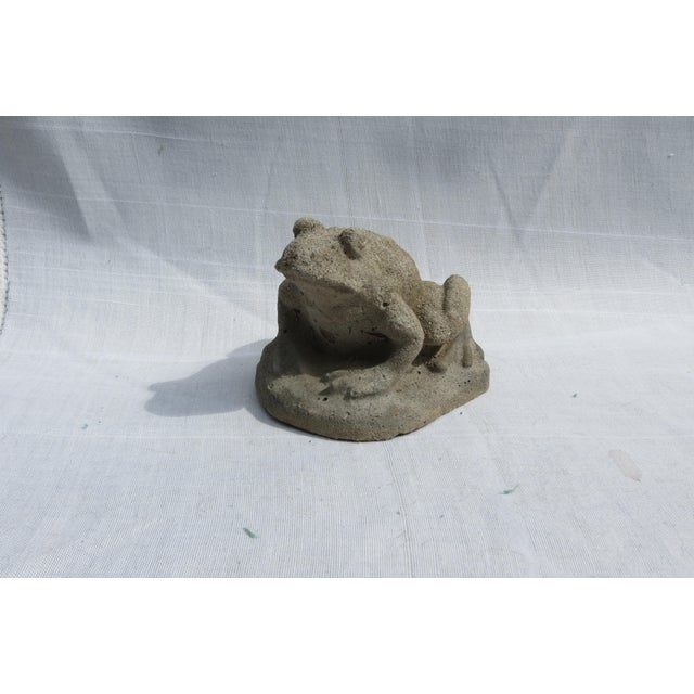 """This charming cast stone frog garden ornament was made in England during the mid 20th century. His dimensions are 4"""" tall..."""