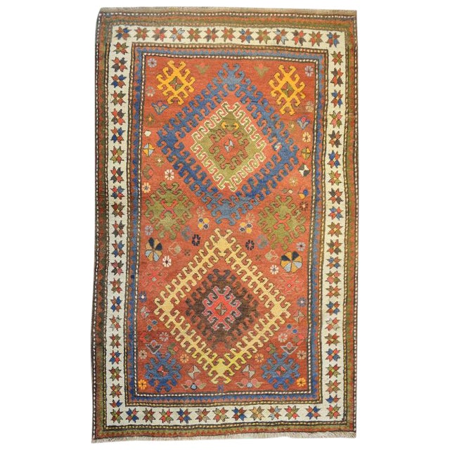 Early 20th Century Kazak Rug - 4′1″ × 5′7″ For Sale