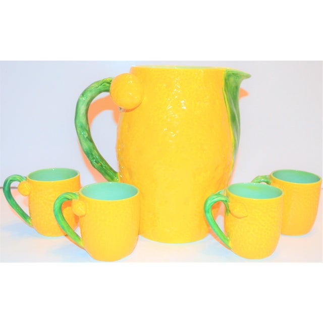 This is a whimsical and exceptionally cheerful Italian Majolica Limoncello Pitcher and Cup set. The tall pitcher is...