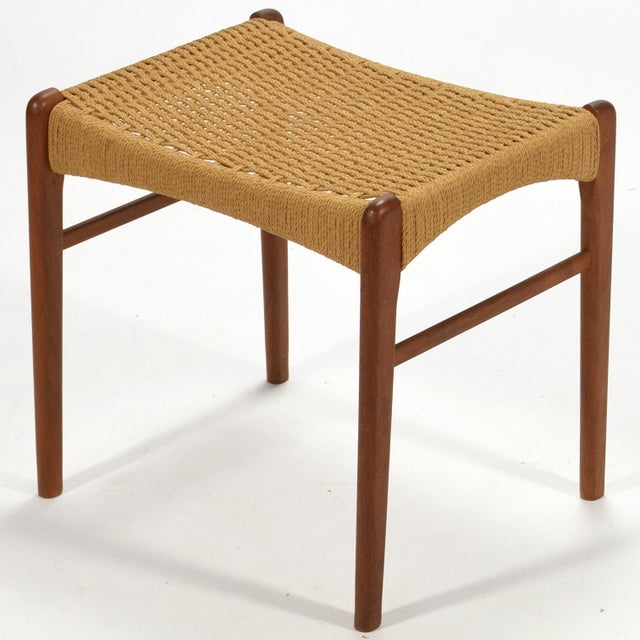 This teak stool by Peder Kristensen for Glyngore Stolefabrick is a beautiful example of Classic Danish modern design....