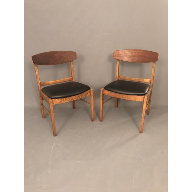 Pair of mid century walnut dining chairs with new black vinyl upholstery. Very good condition.