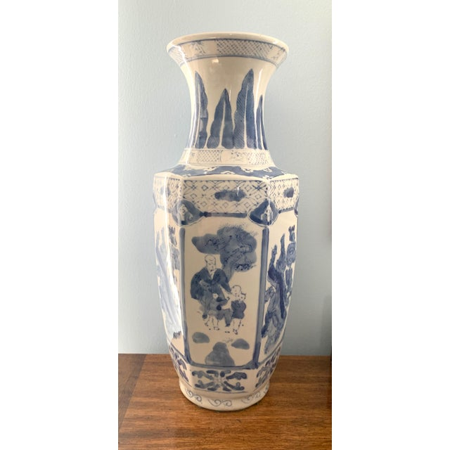 Beautiful oversized blue and white vase with intricate detailing. Made in the mid 20th century.